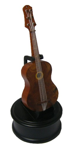 Musical guitar figurine fitted with 18 note musical movement.